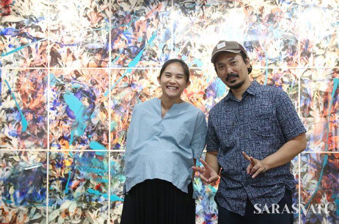 Erika dan Erik dengan latar belakang karya kolaborasi mereka Montage 240 x 360 cm (18 panels), Mix Media in Perspex Sheet, 2017
